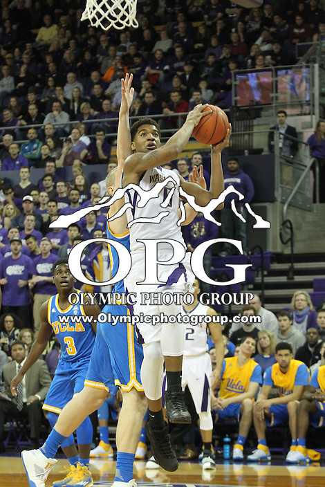 JAN 1, 2016:  Washington's #0 Marquese Chriss drives to the basket against UCLA.  Washington defeated #25 ranked UCLA 96-93 in double overtime at Alaska Airlines Arena in Seattle, WA.