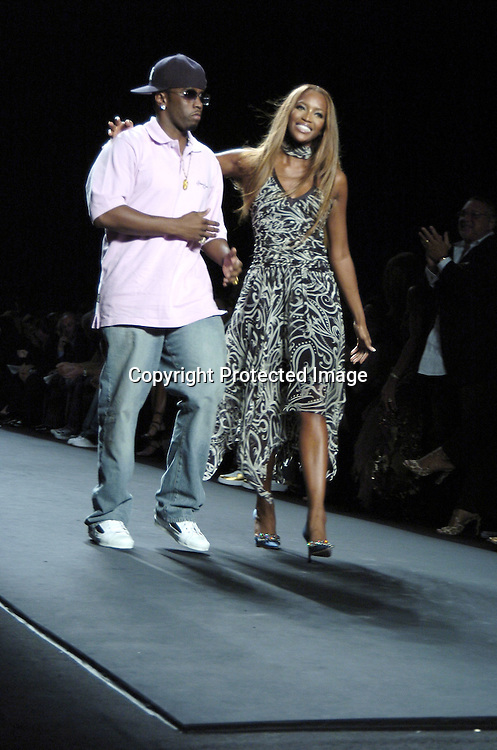 Sean Combs and Naomi Campbell ..at the Fashion For Relief Fashion Show Benefit on September 16, 2005 at The Tents at the Olympus Fashion Week with money to be donatted to AmeriCares. ..Photo by Robin Platzer, Twin Images