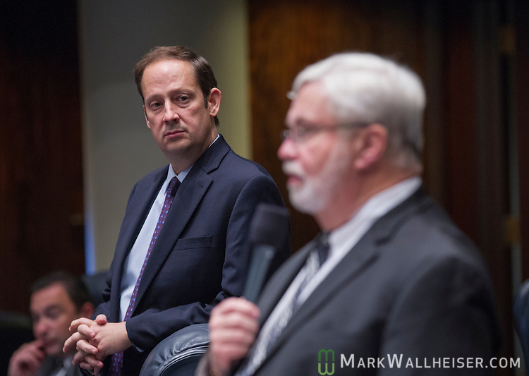 TALLAHASSEE, FL - May 1, 2014:  Opposition Senator Joe Negron (left) listens as Florida Senator Jack Latvala debates a bill he co-sponsors allowing undocumented students to pay in-state tuition for state colleges.