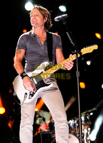 Keith Urban<br /> 2013 CMA Music Festival Nightly Concert held at LP Field, Nashville, Tennessee, USA, 8th June 2013.<br /> country music gig live on stage performing half length grey gray tshirt playing guitar 3/4 <br /> CAP/ADM/MS<br /> &copy;Mike Strasinger/AdMedia/Capital Pictures