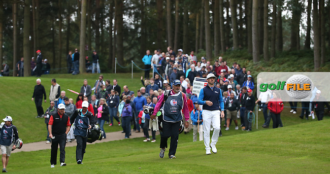 Good crowd follow Wade Ormsby (AUS) and Graeme McDowell (NIR) to the 14th during the Third Round of the British Masters 2015 supported by SkySports played on the Marquess Course at Woburn Golf Club, Little Brickhill, Milton Keynes, England.  10/10/2015. Picture: Golffile | David Lloyd<br /> <br /> All photos usage must carry mandatory copyright credit (&copy; Golffile | David Lloyd)