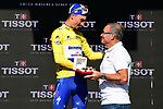Yellow Jersey Julian Alaphilippe (FRA) Deceuninck-Quick Step blitzes the field winning Stage 13 of the 2019 Tour de France, presented with a Tissot watch by cycling legend Bernard Hinault (FRA) ASO, an individual time trial running 27.2km from Pau to Pau, France. 19th July 2019.<br /> Picture: ASO/Alex Broadway | Cyclefile<br /> All photos usage must carry mandatory copyright credit (© Cyclefile | ASO/Alex Broadway)