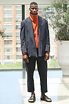 Model David poses in an outfit from the Deveaux Spring Summer 2017 collection on July 13 2016, during New York Fashion Week Men's Spring Summer 2017.