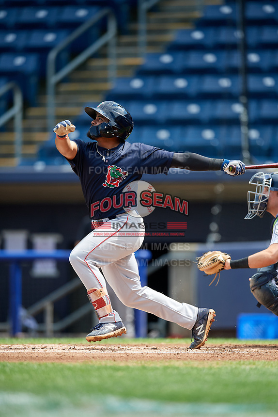 Lowell Spinners third baseman Jonathan Ortega (29) follows through on a swing during a game against the Staten Island Yankees on August 22, 2018 at Richmond County Bank Ballpark in Staten Island, New York.  Staten Island defeated Lowell 10-4.  (Mike Janes/Four Seam Images)