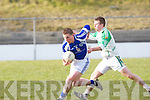Templenoe's Danny Cahilane gets away from Ballydonoghue's Diarmuid Behan in the 1st round of the Novice Championship at Ballydonoghue on Saturday.