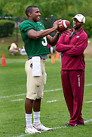 TALLAHASSEE, FLA. 3/26/11-FSU032611 CH-EJ Manuel, left, talks with Quarterbacks Coach Dameyune Craig during practice Saturday in Tallahassee..COLIN HACKLEY PHOTO