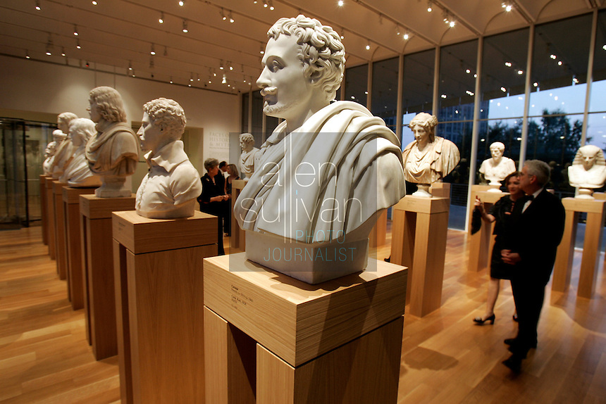Guests view busts at the Anne Cox Chambers Wing of the High Museum of Art. Over the next three years, the High Museum will feature hundreds of works of art from the Musée de Louvre.