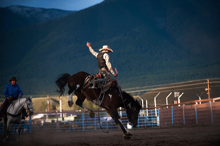 A cowboy rides a bronco at the Bucking Horse Futurity in Eureka, Montana.
