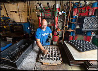 BNPS.co.uk (01202 558833)<br /> Pic: PhilYeomans/BNPS<br /> <br /> Rubber nuggets being placed in the moulds.<br /> <br /> Price of Bath was set up by her grandfather Joseph in the 1930's and after WW2 employed 120 people churning out 84,000 balls a week - nowadays it's the last tennis ball maker in the western world, and produces a much more modest 6000 balls a week from raw rubber from Malaysia to finished product.<br /> <br /> Louise's father Derek, who invented the rubber tiles used on nuclear powered submarines as well as running the family business, still works full time in the dickensian factory at the age of 88.