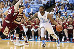 18 January 2014: North Carolina's Leslie McDonald (2) is defended by Boston College's Lonnie Jackson (20) and Joe Rahon (25). The University of North Carolina Tar Heels played the Boston College Eagles in an NCAA Division I Men's basketball game at the Dean E. Smith Center in Chapel Hill, North Carolina. UNC won the game 82-71.