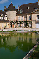 The main building with its tower and a pond with a reflection Chateau Bouscaut Cru Classe Cadaujac Graves Pessac Leognan Bordeaux Gironde Aquitaine France