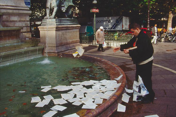 Paris, France, Street scene off Boulevard Saint Michel, Left Bank, 6th Arrondissement, Europe, man destroying a book pages at a time..