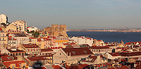 Rooftop view over the city, with the Se de Lisboa or Lisbon Cathedral, with the Tagus river behind, Lisbon, Portugal. Parts of the original 12th century building remain, but the cathedral has been partially rebuilt many times after earthquakes. Picture by Manuel Cohen