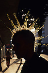 "Young street kid with spiked mohawk along ""The Ave"" University District, backlit silhouetted, Seattle, Washington State USA"