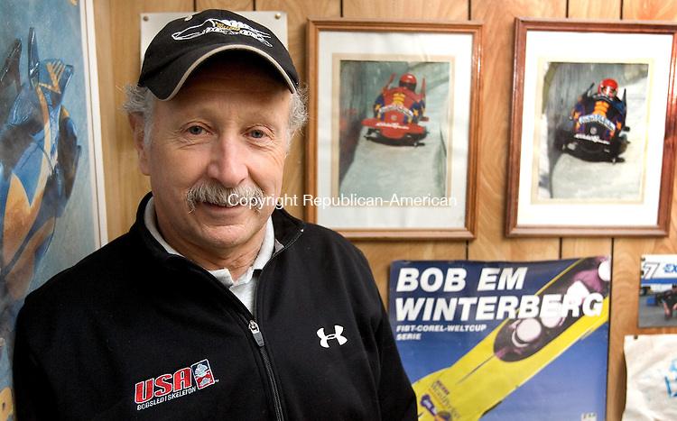 WOLCOTT, CT. 27 January 2010-012710SV04--Frank Briglia of Wolcott stand among his many bobsled photos in auto body shop in Wolcott Wednesday. Briglia is a mechanic for the USA bobsled team.<br /> Steven Valenti Republican-American