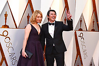 Yvonne Boismier Phillips, left, and Lou Diamond Phillips arrive at the Oscars on Sunday, March 4, 2018, at the Dolby Theatre in Los Angeles. (Photo by Jordan Strauss/Invision/AP)