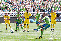 Seattle Sounders FC midfielder Mauro Rosales (10) shoots and scores on a penalty kick in a match against Columbus Crew at CenturyLink Field in Seattle, Washington.