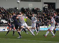 Sam Parkin being challenged by Scott Boyd in the St Mirren v Ross County Clydesdale Bank Scottish Premier League match played at St Mirren Park, Paisley on 19.1.13.