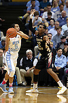 24 January 2015: North Carolina's Marcus Paige (5) and Florida State's Xavier Rathan-Mayes (CAN) (22). The University of North Carolina Tar Heels played the Florida State University Seminoles in an NCAA Division I Men's basketball game at the Dean E. Smith Center in Chapel Hill, North Carolina. UNC won the game 78-74.