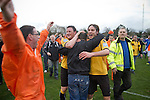 Wealdstone 0 Newport County 0, 17/03/2012. St Georges Stadium, FA Trophy Semi Final. Visiting supporters and players celebrating at the final whistle at St Georges Stadium, home ground of Wealdstone FC, as the club played host to Newport County (yellow) in the semi-final second leg of the F.A. Trophy. The game ended in a goalless draw, watched by a capacity crowd of 2,092 which meant the visitors from Wales progressed by three goals to one to the competition's final at Wembley, where they would meet York City. The F.A. Trophy was the premier cup competition for non-League clubs in England and Wales affiliated to the Football Association. Photo by Colin McPherson.