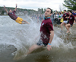 A group calling themselves Team Hart,  head into the water, during the annual Polar Plunge at Crystal Lake, Saturday, March 24, 2012. organizer Agent Ron Littell with the South Windsor Police Department said they raised more than $30,000 for Special Olympics. (Jim Michaud/Journal Inquirer) TEST