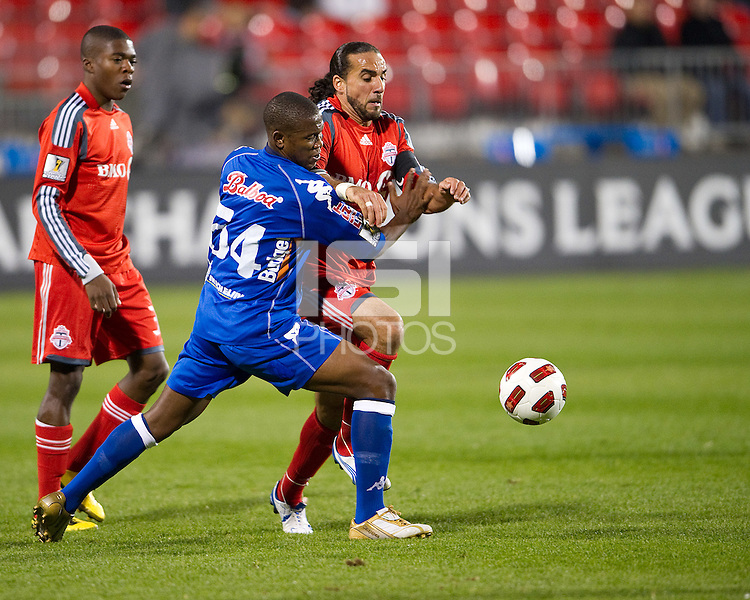 19 October 2010: Toronto FC forward Dwayne De Rosario #14 and Arabe Unido Rigoberto Nino #54 in action during a CONCACAF game between Arabe Unido and Toronto FC at BMO Field in Toronto..