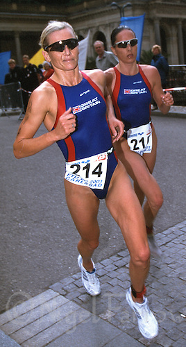 23 JUN 2001 - KARLOVY VARY, CZE - Michelle Dillon (left) and Annie Emmerson lead the field on the run during the Elite Womens European Triathlon Championships (PHOTO (C) NIGEL FARROW)