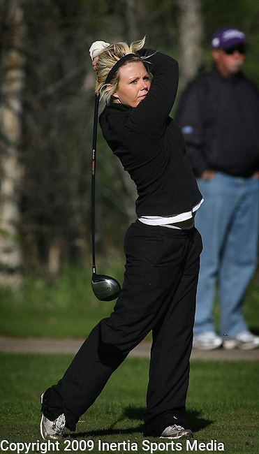 RAPID CITY, SD - MAY 13, 2009 :  Larissa Rantapaa of S.D. Tech watches her tee shot on the third hole at Meadowbrook Golf Course in Rapid City Wednesday during the 2009 NAIA Women's Golf National Championships. (Photo by Dick Carlson/Inertia)