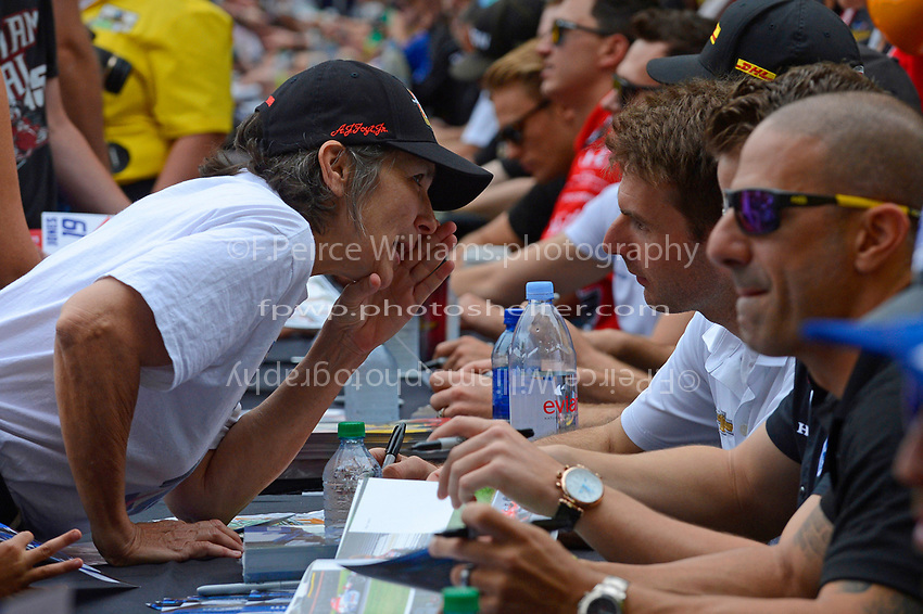 Verizon IndyCar Series<br /> Indianapolis 500 Drivers Meeting<br /> Indianapolis Motor Speedway, Indianapolis, IN USA<br /> Saturday 27 May 2017<br /> Driver's autograph session: Will Power, Team Penske Chevrolet talks with a fan.<br /> World Copyright: F. Peirce Williams