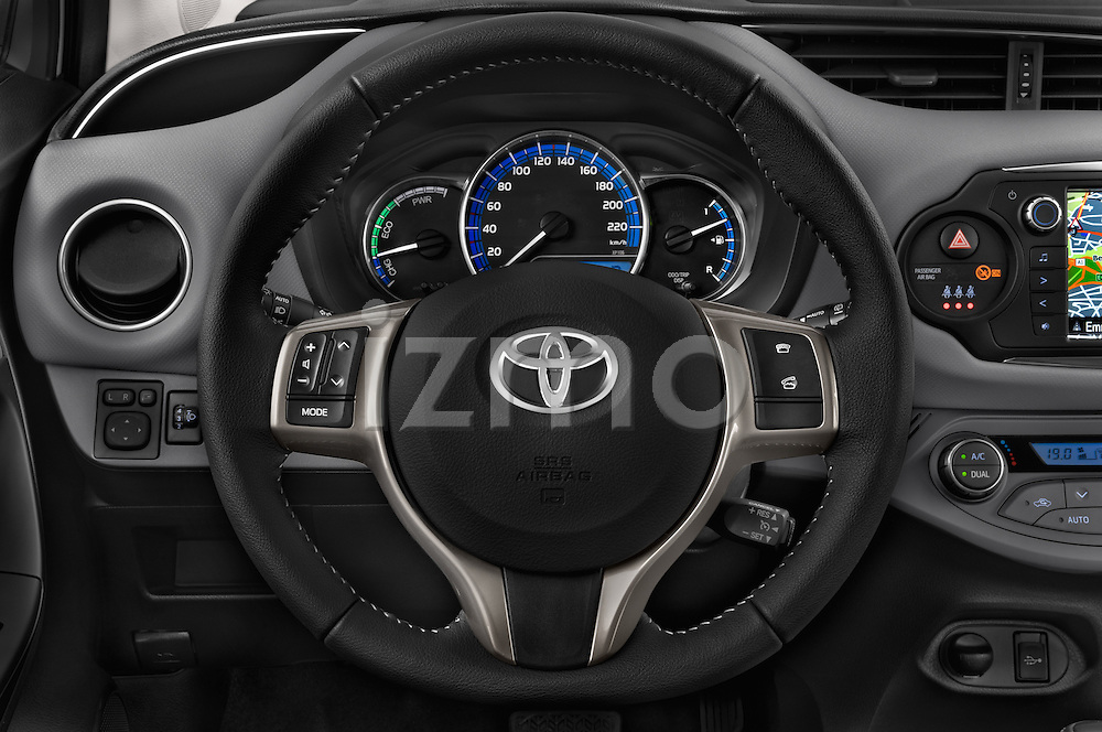 Car pictures of steering wheel view of a 2015 Toyota Yaris Hybride Lounge 5 Door Hatchback 2WD Steering Wheel