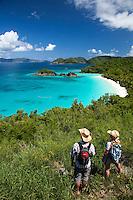 Hikers overlooking Trunk Bay<br /> Virgin Islands National Park<br /> St. John, U.S. Virgin Islands