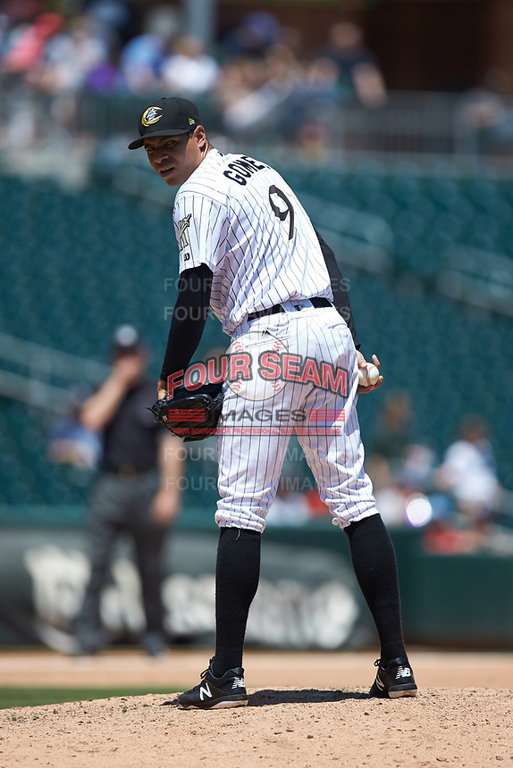 Charlotte Knights relief pitcher Jeanmar Gomez (9) checks the runner on first base during the game against the Gwinnett Stripers at BB&T BallPark on May 2, 2018 in Charlotte, North Carolina.  The Knights defeated the Stripers 6-5.  (Brian Westerholt/Four Seam Images)