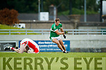 Tomas Mac an tSaoir West Kerry in action against James O'Donoghue Legion in the Quarter Final of the Kerry Senior County Championship at Austin Stack Park on Sunday.