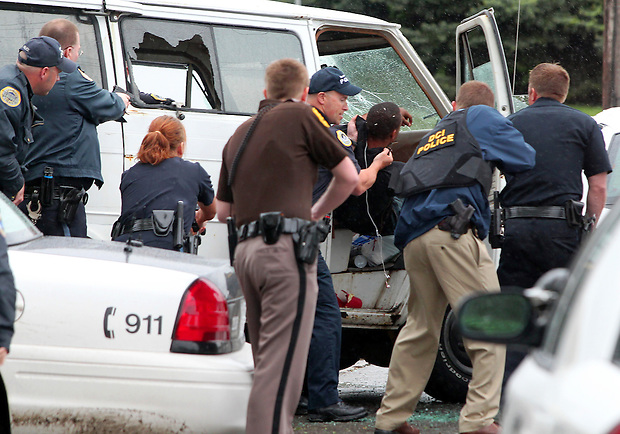 Law enforcement officers pull a robbery suspect from a van  near the 1900 block of Hubbell Avenue following a bank robbery and carjacking May 13, 2011 in Des Moines.