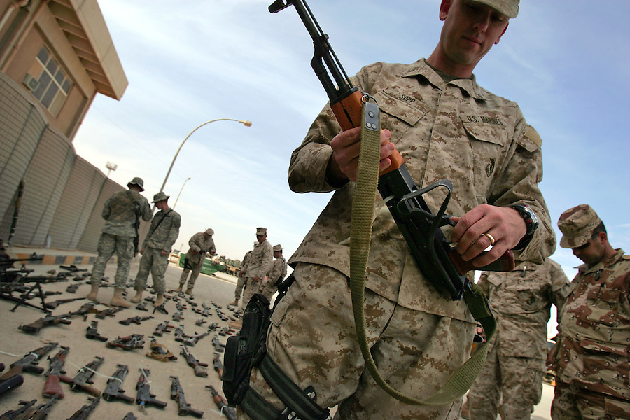 Marines and soldiers stationed at Forward Operating Base Al Qa'im examine weapons captured during the recently completed Operation Steel Curtain on Sat. Nov. 19, 2005. The operation was part of a year-long push by US forces to disrupt and counter insurgent activity along the Euphrates River valley from the Syrian border to central Iraq.