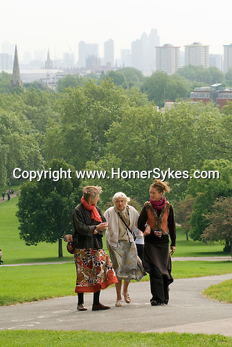 Three generations, grandmother, daughter, granddaughter together,  walk to the top of Primrose Hill. London UK 2008