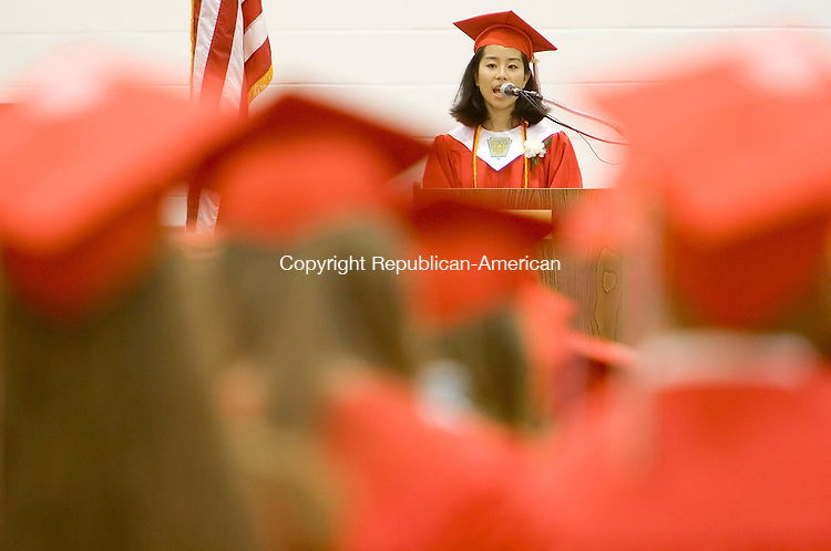 SOUTHBURY, CT--20 JUNE 2006 -062006JS02- Pomperaug High School graduating senior and class Valedictorian Dorothy Ruolan Du gives her speech during commencement Wednesday at Pomperaug High School in Southbury.-- Jim Shannon Republican-American