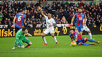 Andre Ayew of Swansea (C) protests to the referee asking for a handball during the Barclays Premier League match between Swansea City and Crystal Palace at the Liberty Stadium, Swansea on February 06 2016