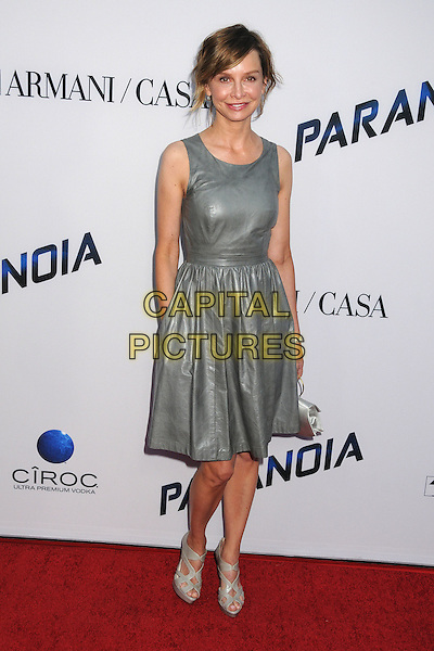 Calista Flockhart<br /> &quot;Paranoia&quot; Los Angeles Premiere held at the Directors Guild of America, West Hollywood, California, USA, 8th August 2013.<br /> full length dress silver grey gray leather smiling sleeveless hand in pocket <br /> CAP/ADM/BP<br /> &copy;Byron Purvis/AdMedia/Capital Pictures