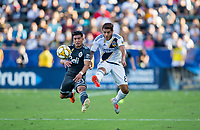 CARSON, CA - SEPTEMBER 29: Michaell Chirinos #33 of the Vancouver Whitecaps and Jonathan dos Santos #8 of the Los Angeles Galaxy battle for a ball during a game between Vancouver Whitecaps and Los Angeles Galaxy at Dignity Health Sports Park on September 29, 2019 in Carson, California.