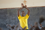 A girl leads a class in the Loreto Primary School in Rumbek, South Sudan. The Loreto Sisters began a secondary school for girls in 2008, with students from throughout the country, but soon after added a primary in response to local community demands.<br /> <br /> The older girl leading the class is a student of the Loreto Girls Secondary School. She took charge of the primary class so the regular teacher could attend a staff meeting.