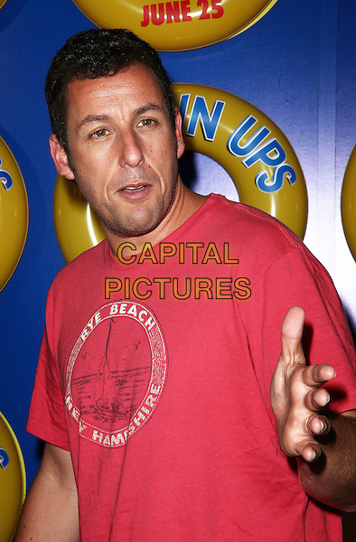 ADAM SANDLER .The screening of 'Grown Ups' at the Ziegfeld Theatre in New York City, NY, USA, 23rd June 2010..arrivals half length red t-shirt hand .CAP/ADM/PZ.©Paul Zimmerman/AdMedia/Capital Pictures.