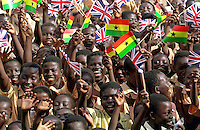CHILDREN WAVING FLAGS AT THE WIRELESS CLUSTER JUNIOR SCHOOL, ACCRA.