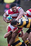 Elisi Pulu pushes Josh Stol out of the way as he tries to get free from Josh Allen's tackle.  Counties Manukau Premier Club Rugby game between Bombay and Karaka, played at Bombay, on Saturday March 15 2014. Karaka won the game 39 - 12 after leading 13 - 5 at halftime.  Photo by Richard Spranger