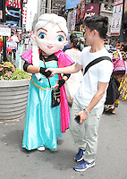NEW YORK, NY - JUNE 21: Costumed character soliciting a reluctant passerby outside of green zone on the first day of NYPD (New York Police Department) enforcement of the new pedestrian zones in Times Square where costumed characters and those selling bus or show tickets are required to solicit only in the designated green zone in New York, New York on June 21, 2016.  Photo Credit: Rainmaker Photo/MediaPunch