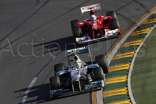 18.03.2012. Melbourne, Australia.   FIA Formula One World Championship 2012 Grand Prix of Australia 8 Nico Rosberg ger Mercedes AMG Petronas F1 team nd  Fernando Alonso ESP Scuderia Ferrari Jenson Button won the race with Sebbastian Vettel in second and Lewis Hamilton in third place.