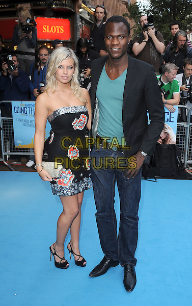 GUEST & BRIAN BELO.The World Premiere of 'Going The Distance', Empire Leicester Square, London, England..19th August 2010.full length strapless black dress silver sequined jacket green t-shirt jeans denim bello. CAP/BEL.©Tom Belcher/Capital Pictures.