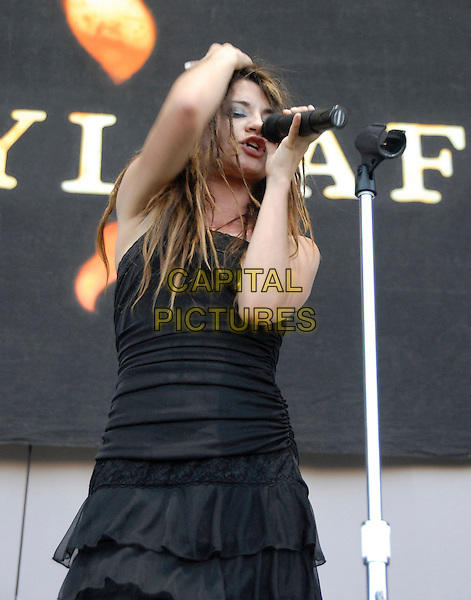 FLYLEAF.Performs with a fan from Myspace live at The Family Values Tour held at The Hyundai Pavilion in San Bernadino, California, USA,  August 19th 2006..half length band music live concert on stage black dress .Ref: DVS.www.capitalpictures.com.sales@capitalpictures.com.©Debbie VanStory/Capital Pictures
