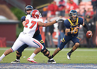 Zach Maynard of California runs the ball away from Donavan Lewis of Fresno State during the game at Candlestick Park in San Francisco, California on September 3rd, 2011.  California defeated Fresno State, 36-21.