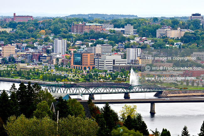 "The Saguenay borough of Chicoutimi skyline is pictured September 24, 2008. Located 225 kilometres north of Quebec City ,Chicoutimi is one of the three boroughs of Saguenay, Quebec, Canada, and was a separate city in its own right until 2002. Situated at the confluence of the Chicoutimi and Saguenay Rivers, the placename is derived from Shkoutimeou, meaning ""the end of the deep water"" in the Montagnais dialect."